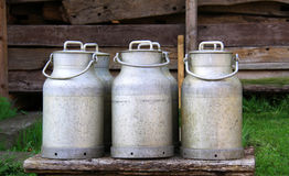 Rural metal cans of milk. Milk products, agricultural stock photography