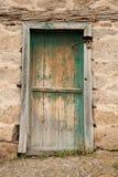 Rural, natural old wooden door. Old wooden door used in the village Stock Images