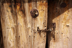 Rural, natural old wooden door. Old wooden door used in the village Stock Photography