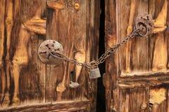 Rural, natural old wooden door. Old wooden door used in the village Royalty Free Stock Images