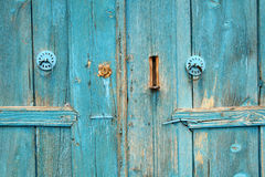Rural, natural old wooden door. Old wooden door used in the village Stock Image