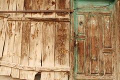Rural, natural old wooden door. Old wooden door used in the village Royalty Free Stock Photos