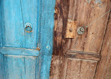 Rural, natural old wooden door. Old wooden door used in the village Royalty Free Stock Photo