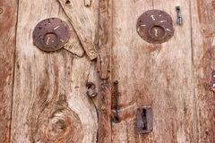 Rural, natural old wooden door. Old wooden door used in the village Stock Photos