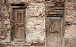 Rural, natural old wooden door. Old wooden door used in the village Stock Photo