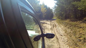 Rural off road. Car driving through the countryside. The camera is right outside stock footage