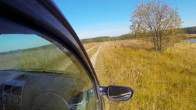Rural off road. Car driving through the countryside. The camera is right outside stock video