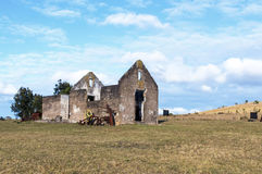 Rural Old  Derelect Farm Building on Dry Winter Landscape. Rural old abandoned derelect farm building on dry winter landscape against blue cloudy sky in Lake Royalty Free Stock Images