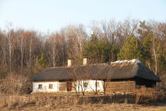 Rural old hut in the wood. Ukrainian architecture. Royalty Free Stock Photo
