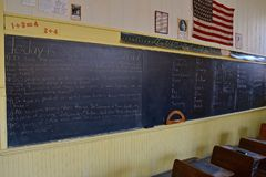 Rural one room schoolhouse. Blackboard chalk lessons for students in an old one room rural schoolhouse stock photo