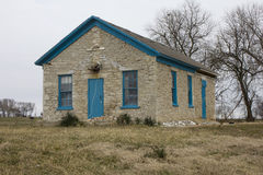 Rural One Room Stone Schoolhouse. An abandoned one-room rural school house located in Missouri, United States.  Front view of the old school building showing the Royalty Free Stock Photography