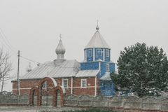 Rural orthodox church. Small rural orthodox church is in a snowy weather Royalty Free Stock Images