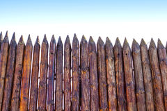 Rural paling from logs. Against the sky Royalty Free Stock Photography