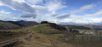 Rural panorama. Splendid panoramic scenery of the countryside in early springtime Stock Photos