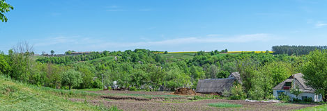 Rural panorama. Panoramic view of a typical rural area in the early spring during the processing of agricultural land Royalty Free Stock Images