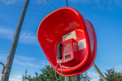 Rural payphone. Red payphone in rural areas stock image