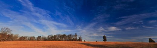 Rural peaceful scenery with deep blue sky Royalty Free Stock Photos