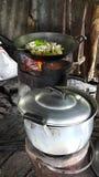 Rural peopke cooking. Morning pot cooking Royalty Free Stock Photos