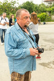 Rural photoreporter at the Nestinar Games in the village of Bulgari, Bulgaria Stock Image