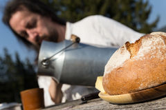 Rural picnic with milk churn and bread Stock Photo