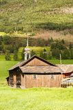 Rural place in Norway. Old wooden houses and church in the rural place in Norway Royalty Free Stock Photography