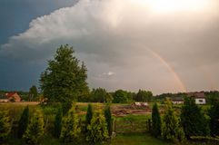 Rural Poland, Ilawa region, rainbow over village of Sapy royalty free stock images