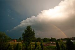 Rural Poland, Ilawa region, rainbow over village of Sapy stock images