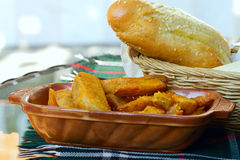 Rural potatoes and bread. Very tasty rural fried potatoes with bread Royalty Free Stock Photography