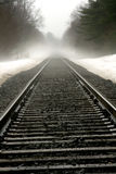 Rural Railroad Tracks. Abstract of rural railroad tracks on spring day with fog Royalty Free Stock Photos