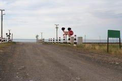 Rural railway crossing Stock Photo