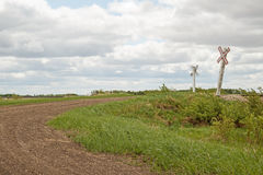 Rural railway crossing signs Stock Photography