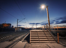 Rural railway station at night with blue sky. Railroad Royalty Free Stock Image
