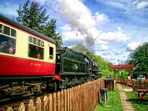 The Rural Railway. A steam train travels through rural Shropshire on a sunny day royalty free stock images