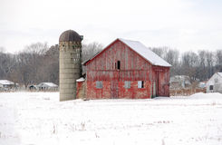 Rural red barn in the snow Royalty Free Stock Images
