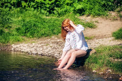 Rural red-haired girl  on the river Royalty Free Stock Photo