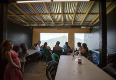 Rural Restaurant in Puerto Rico. SAN JUAN, PUERTO RICO - MARCH 21:  Locals gather at a rural establishment in Puerto Rico's El Yunque region on March 21, 2016 Royalty Free Stock Photo