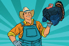 Rural retro farmer with a beautiful living Turkey Royalty Free Stock Images