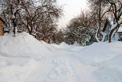 Rural road. Big snowy snowdrifts on the rural road Stock Images