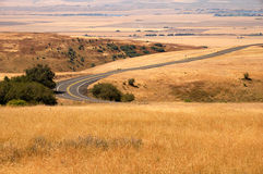 Rural Road. A rural mountain road winding through rolling hills to a valley Stock Photography