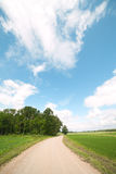 Rural road. Gravel road in nice summer day Stock Images
