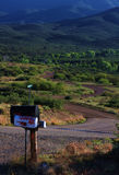 Rural Road. A winding rural road in Arizona with mailbox on the foreground royalty free stock photography