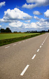 Rural Road. A small countryside road among fields of crops in the Netherlands Stock Image
