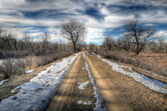 Rural road. In Wyoming late Winter, HDR Royalty Free Stock Photo
