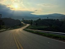 Rural road along the mountain in Thailand Royalty Free Stock Image
