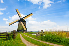 Free Rural Road And Windmill In Netherlands Royalty Free Stock Images - 49882099