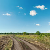 Rural road and blue sky Royalty Free Stock Images