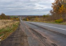 Rural road at cloudy autumnal day in Sumskaya oblast, Ukraine Stock Image