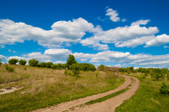 Rural road in the de. Sert under a blue sky royalty free stock photography