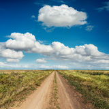 Rural road and deep blue sky Stock Photography
