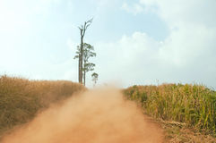 Rural road. Dust on rural road in Thailand Stock Photos